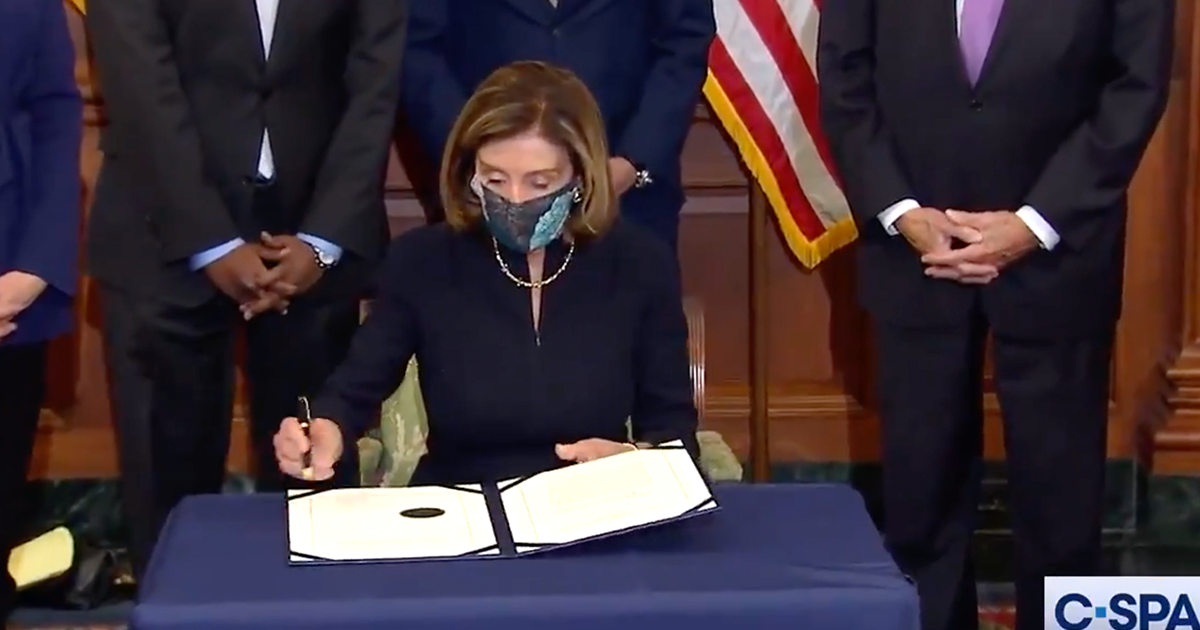 WATCH: Pelosi signs Article of Impeachment Against Trump